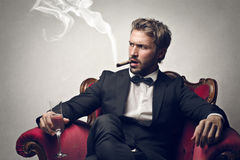 Man smoking a cigar Royalty Free Stock Image