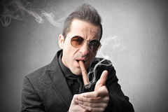 Man smoking a cigar Royalty Free Stock Photo