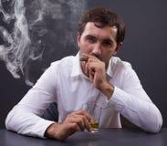 Man smoking a cigar Stock Image
