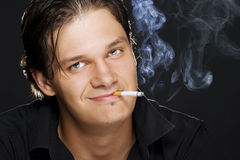Man smoking a cigarette Stock Photos