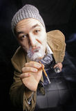 A man smoking a cigarette Stock Photo