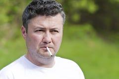 Man smoking cigarette Stock Images
