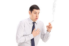 Man smoking a cigarette and feeling chest pain Stock Image
