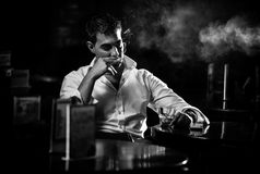 Man smoking cigarette in restaurant Royalty Free Stock Photography