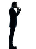 Man smoking cigarette silhouette Royalty Free Stock Photo