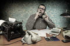Man smoking a cigarette while talking on the phone Stock Image