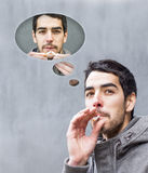 Man smoking a cigarette and think about smoking. Stock Photos