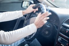 Man smoking a cigarette at the wheel of a car. Driving and smoking stock photo