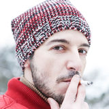 Man smoking cigarette in winter Stock Photos
