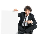 Man In Smoking Displaying Placard Stock Photo