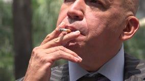 Man Smoking and Drinking stock video footage
