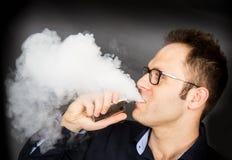 Man smoking electronic cigarette. A man smoking electronic cigarette Stock Photo
