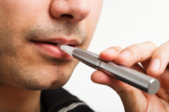 Man smoking an electronic cigarette Stock Images
