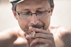 Man smoking hashish joint Stock Images
