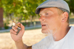 Man smoking a home rolled cigarette Stock Image