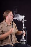 Man smoking hookah Royalty Free Stock Photos