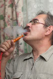 Man smoking a hookah Stock Photos