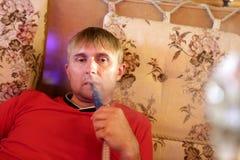 Man smoking hookah Stock Photography