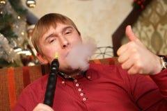 Man smoking hookah Royalty Free Stock Photo