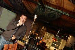 Man smoking hookah Royalty Free Stock Photography