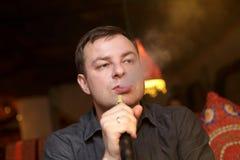 Man smoking nargile Royalty Free Stock Photography