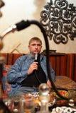 Man smoking nargile Stock Photo