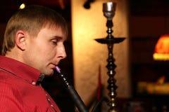 Man smoking nargile Royalty Free Stock Images