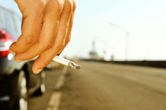 Man smoking on a no traffic road Royalty Free Stock Image