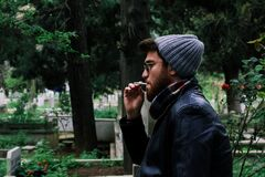 Man smoking outdoors Royalty Free Stock Photos
