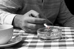 Man smoking outside selective color Royalty Free Stock Photos
