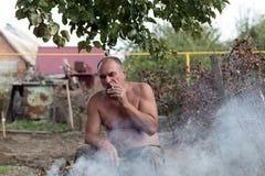 Man smoking at picnic Royalty Free Stock Photos