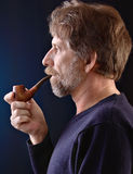 Man smoking a pipe Royalty Free Stock Images