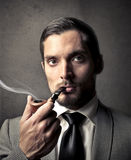 Man smoking a pipe Stock Photos