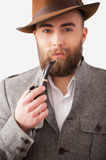 Man with a smoking pipe. Royalty Free Stock Photography