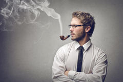 Man smoking a pipe Stock Image