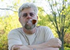 Man smoking a pipe Royalty Free Stock Photos