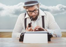 Man with smoking pipe using vintage type writer against cloud. Digital composite image of man with smoking pipe using vintage type writer against cloud Stock Image