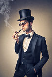 Man smoking a pipe Stock Photo