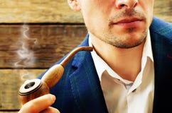 Man smoking a pipe Stock Images