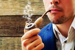 Man smoking a pipe Royalty Free Stock Image