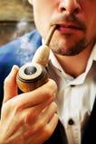 Man smoking a pipe Stock Photo