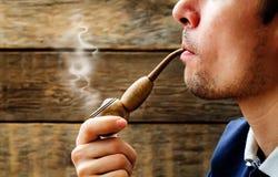 Man smoking a pipe Royalty Free Stock Photo