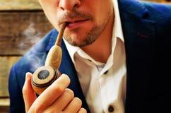 Man smoking a pipe Stock Photos