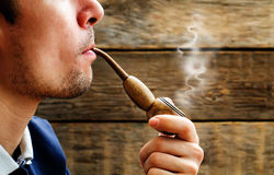 Man smoking a pipe Royalty Free Stock Photography