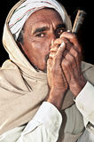 Man smoking in Pushkar Stock Image