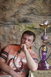 Man is smoking shisha Stock Image