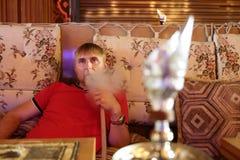 Man smoking shisha Royalty Free Stock Images