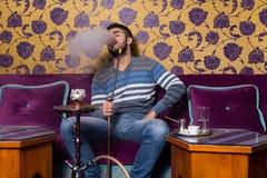 Man Smoking Shisha In The Arabic Cafe Stock Image