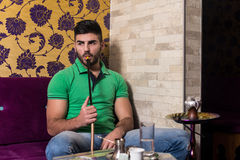 Man Smoking Shisha In The Arabic Cafe Stock Images