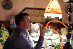 Man smoking shisha Stock Images